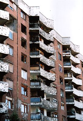 Bullet-riddled residential block